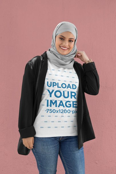 T-Shirt Mockup of a Woman Wearing a Hijab Against a Customizable Background 28384