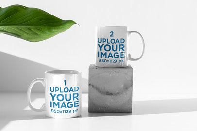 Mockup of Two 11 oz Coffee Mugs by an Indoor Plant 398-el