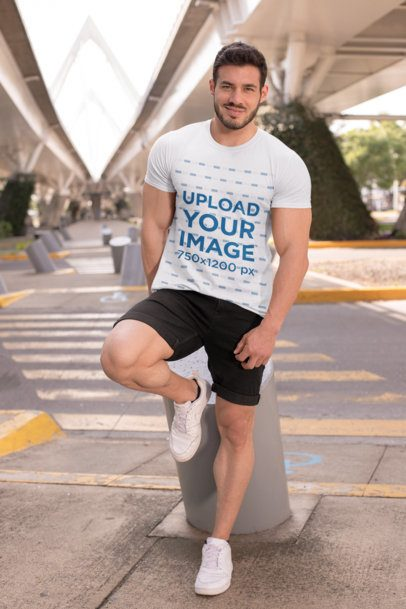 T-Shirt Mockup Featuring a Fit Man Under a City Bridge 28521