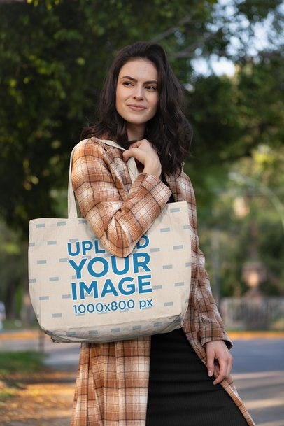 Mockup of a Woman Carrying a Tote Bag on the Street 28862
