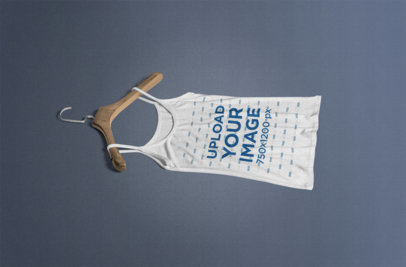 Tank Top Mockup Featuring a Wooden Hanger and a Solid Color Background 366-el
