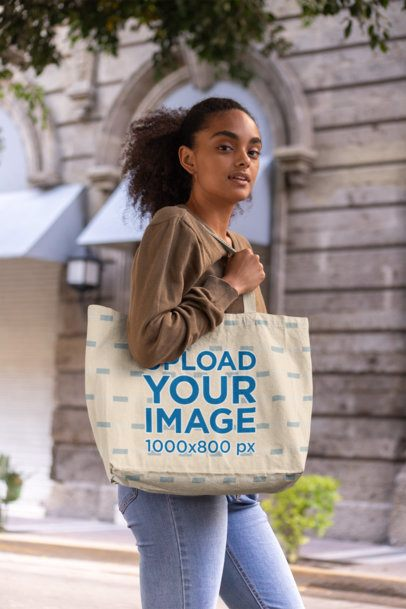 Mockup of a Curly-Haired Woman with a Tote Bag 28847