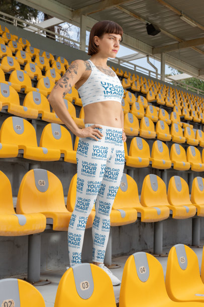 Mockup of a Woman Wearing a Sports Bra and Leggings at a Stadium 28727