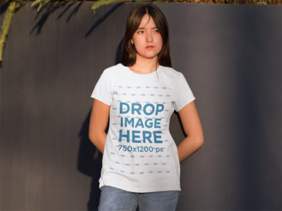T-Shirt Mockup of an Asian Girl Standing in a Courtyard 9173f