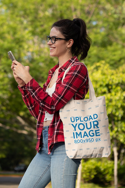 Mockup of a Happy Woman Texting and Carrying a Tote Bag 28831