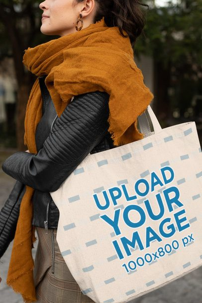 Mockup of a Woman Carrying a Tote Bag and Walking on the Street 28858