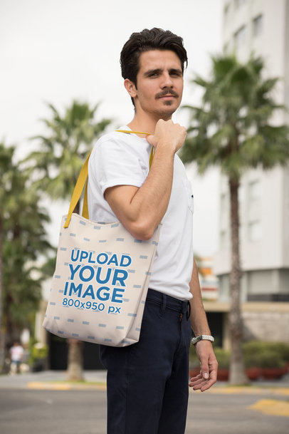 Mockup of a Man Carrying a Tote Bag in the City 28843