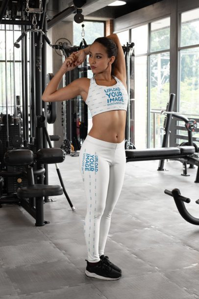 Sports Bra Mockup of a Woman with Leggings Stretching at a Gym 28697