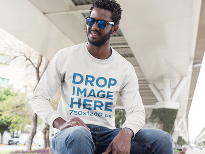 Long Sleeve T-Shirt Mockup of a Man Sitting on a Bench a9450
