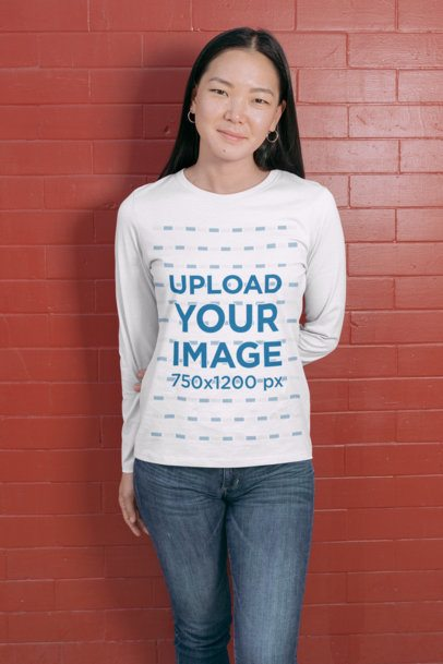Mockup of a Woman Wearing a Long Sleeve Tee Against a Red Brick Wall 29066