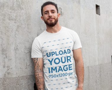 Heathered Tee Mockup of a Man Leaning Against a Concrete Wall 28618