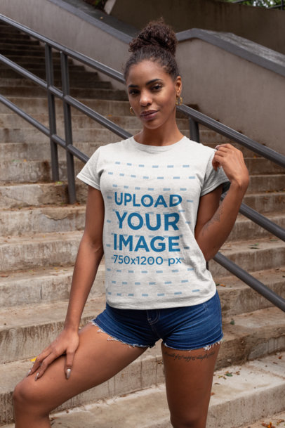 Mockup of a Woman Wearing a Heathered T-Shirt and Denim Shorts Outside 28637