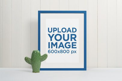 Minimal Picture Frame Mockup Featuring a Ceramic Cactus 545-el