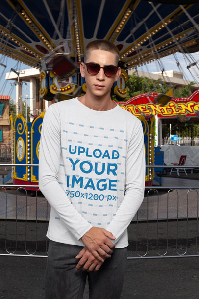 Long Sleeve T-Shirt Mockup of a Man Standing in Front of a Swing Carousel Ride 29036