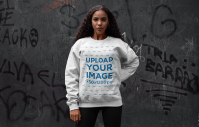 Crewneck Sweatshirt Mockup of a Woman Posing Against a Graffiti Wall 28638