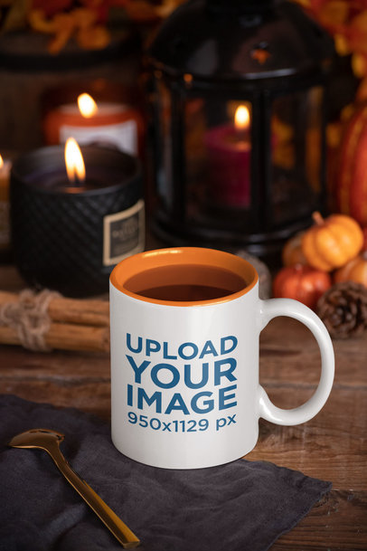 Mockup of an 11 oz Coffee Mug with Fall Decorations in the Background 29171