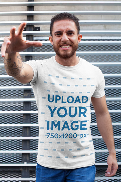 T-Shirt Mockup of a Strong Man Doing a Menacing Pose 28617