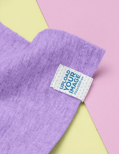 Clothing Label Mockup on a Sleeve Featuring a Bicolored Surface 29028