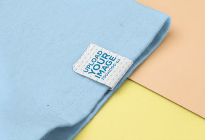 Mockup of a Clothing Label Attached to a Shirt With Two Customizable Backgrounds 29027