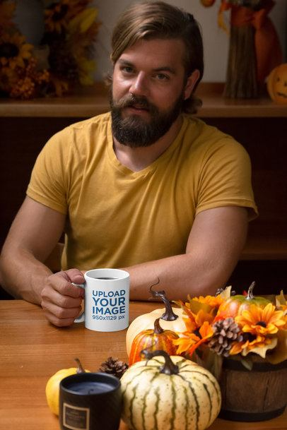 Mockup of a Man Drinking from an 11 oz at the Table 29162