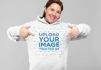Mockup of a Woman Pointing at Her Heathered Hoodie 28803