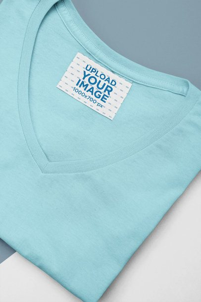 Clothing Label Mockup Featuring a Folded V-Neck T-Shirt 28988