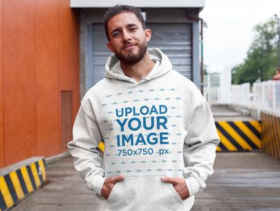 Mockup of a Man Wearing a Heather Hoodie at a Parking Lot 28625
