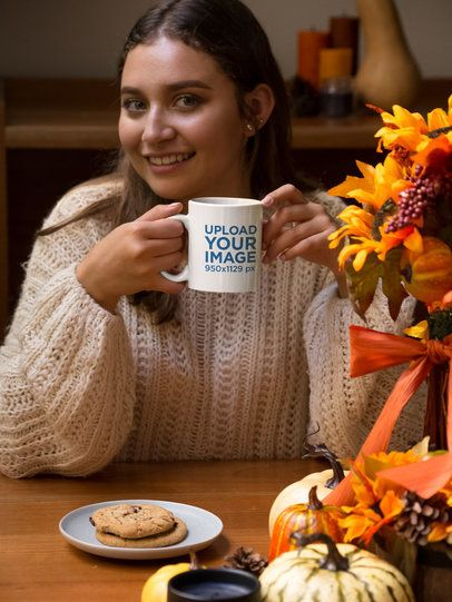 Mockup of a Woman Holding an 11 oz Coffee Mug at a Dinner Table 29137
