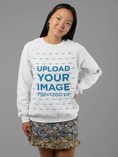 Heather Crewneck Sweatshirt Mockup Featuring a Smiling Woman at a Studio 28754