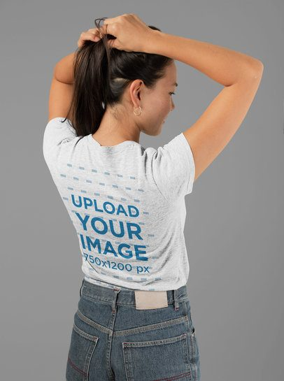 Mockup of the Back of a Heather T-Shirt Featuring a Woman Holding Her Hair 28763