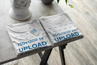 Mockup of a Pair of Folded Tees in a Store with a Prize Tag 378-el