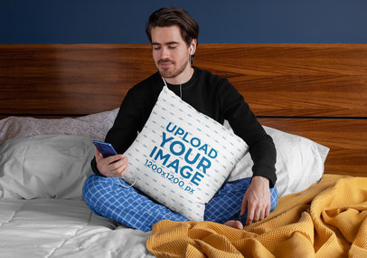 Squared Pillow Mockup Featuring a Man Sitting over a Bed 29023