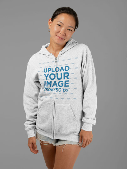 Mockup of a Woman Wearing a Full Zip Heathered Hoodie and Short Shorts 28756