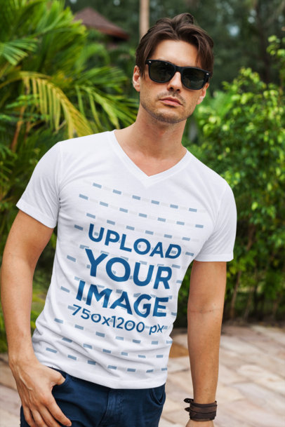 Mockup Featuring a Stylish Man Wearing a V-Neck T-Shirt Against Some Plants 513-el