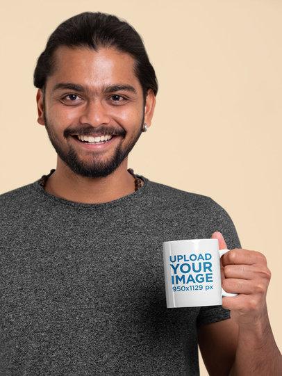 Mockup Featuring a Smiling Man Holding an 11oz Coffee Mug 29091