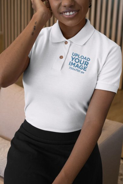 Mockup of a Woman by a Couch Wearing an Embroidered Polo Shirt 28873