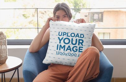 Pillow Mockup Featuring a Woman Hiding Her Face 29015