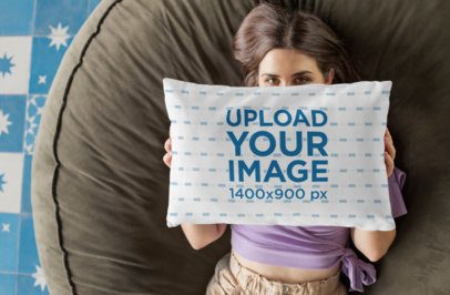 Mockup of a Woman Covering Her Face with a Throw Pillow 29008