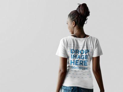 Back Shot of a Black Girl Wearing a V-Neck Tshirt Mockup Facing a Transparent Backdrop a9838b