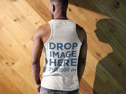 Back Shot of a Black Man Wearing a Tank Top Mockup Facing a Wooden Wall a9363b