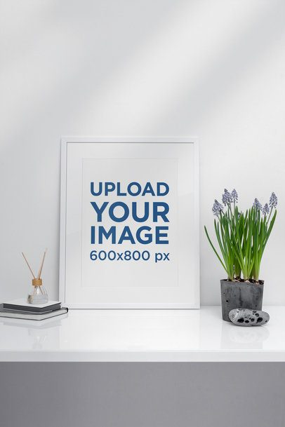Poster Frame Mockup Placed Beside a Plant Pot in a Minimalistic Setting 498-el