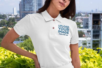 Mockup of a Woman Wearing a Polo Shirt Against a City Background 28898