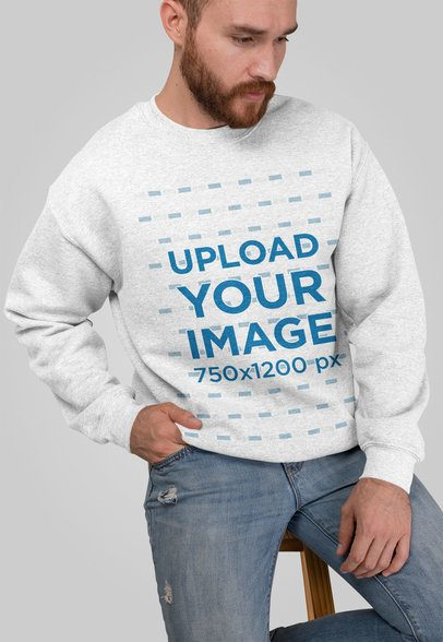 Heathered Crewneck Sweatshirt Mockup Featuring a Man Sitting on a Stool 28745