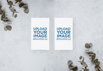 Mockup of Two Vertical Business Cards on a Concrete Surface 641-el