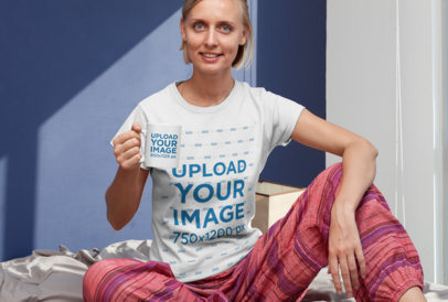 Mockup of a Woman with a T-Shirt and an 11 oz Mug Sitting on a Bed 29270
