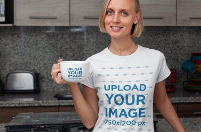 Mockup of a Woman with a T-Shirt and a 24 oz Mug Posing in the Kitchen 29277