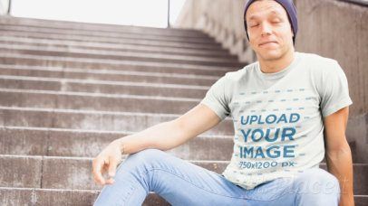 Crewneck T-Shirt Video Featuring a Man Sitting on Concrete Stairs 13028