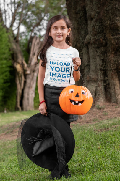 Mockup of a Girl Wearing a T-Shirt and a Witch Costume in the Woods 29296