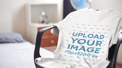 Video of a T-Shirt Placed over a Chair in a Bedroom 13063