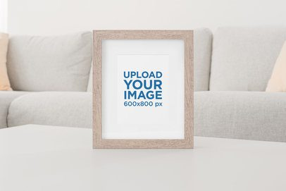Art Print Mockup Featuring a Wooden Picture Frame at a Living Room Table 625-el